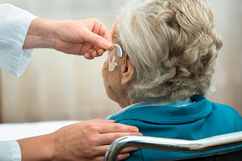 old-woman-hearing-aid